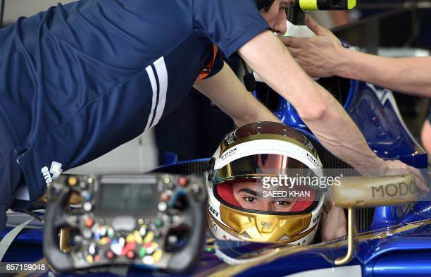 Sauber's German driver Pascal Wehrlein gets ready for the second practice session of the Formula One Australian Grand Prix in Melbourne on March 24...