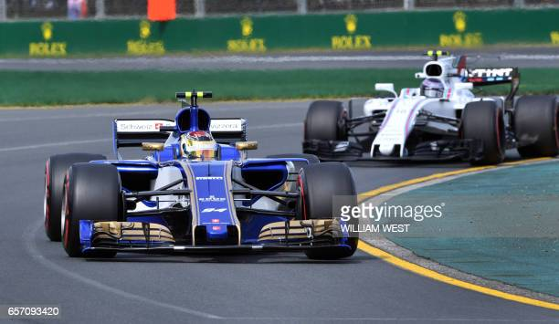 Sauber's German driver Pascal Wehrlein leads Williams' Canadian driver Lance Stroll through a corner during the first practice session at the Formula...