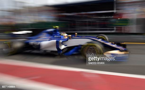 Sauber's German driver Pascal Wehrlein leaves the pitlane during the second practice session for the Formula One Australian Grand Prix in Melbourne...