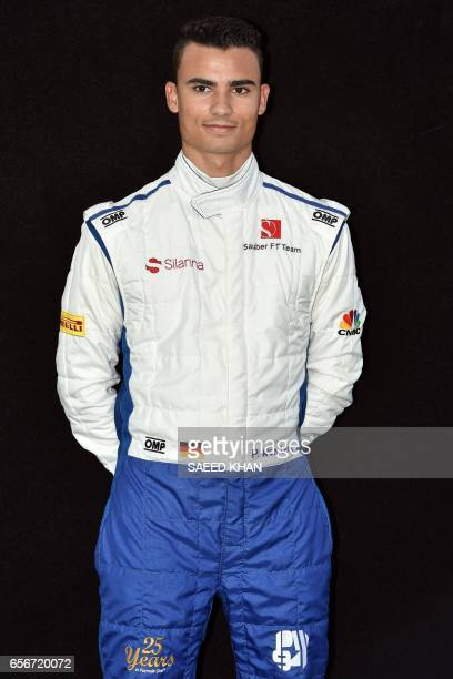 Sauber's German driver Pascal Wehrlein poses for a photo in Melbourne on March 23 ahead of the Formula One Australian Grand Prix / AFP PHOTO / Saeed...