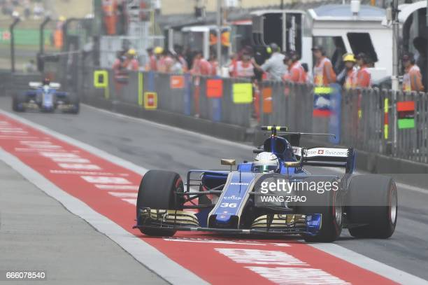 Sauber's Italian driver Antonio Giovinazzi comes into the pits during the qualifying session for the Formula One Chinese Grand Prix in Shanghai on...