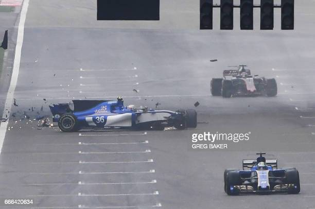 Sauber's Italian driver Antonio Giovinazzi crashes during the Formula One Chinese Grand Prix in Shanghai on April 9 2017 / AFP PHOTO / GREG BAKER