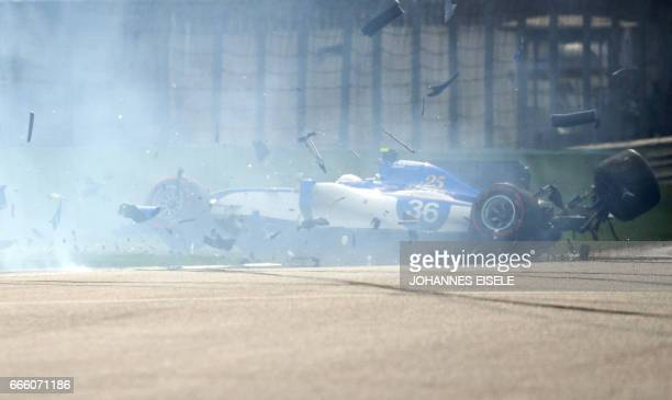 TOPSHOT Sauber's Italian driver Antonio Giovinazzi crashes his car during the qualifying session of the Formula One Chinese Grand Prix in Shanghai on...