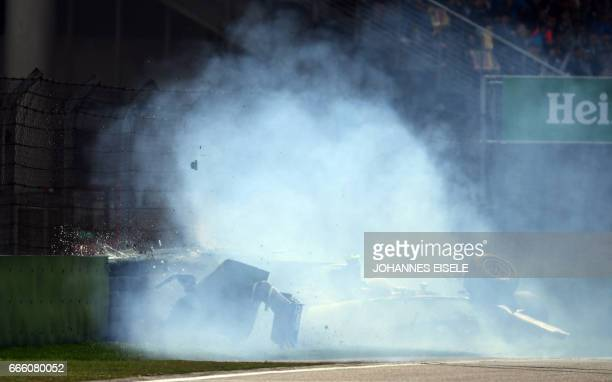 Sauber's Italian driver Antonio Giovinazzi crashes his car during the qualifying session of the Formula One Chinese Grand Prix in Shanghai on April 8...