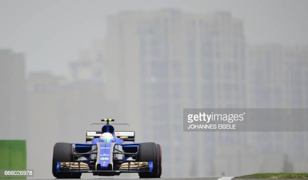 Sauber's Italian driver Antonio Giovinazzi drives his car into pit lane during the third practice session for the Formula One Chinese Grand Prix in...