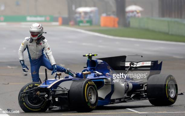 Sauber's Italian driver Antonio Giovinazzi gets out from his car after it crashed during the Formula One Chinese Grand Prix in Shanghai on April 9...