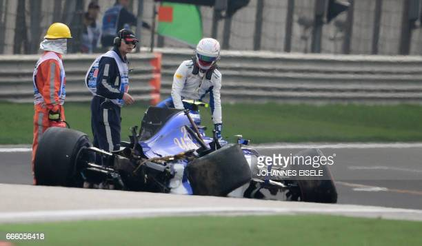 Sauber's Italian driver Antonio Giovinazzi gets out of his car after crashing during the qualifying session of the Formula One Chinese Grand Prix in...