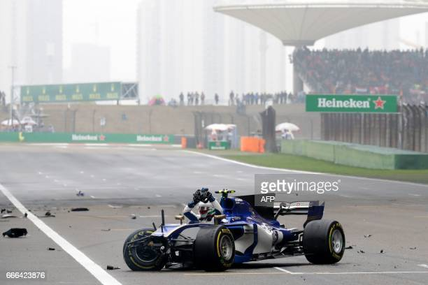TOPSHOT Sauber's Italian driver Antonio Giovinazzi sits in his car after it crashed during the Formula One Chinese Grand Prix in Shanghai on April 9...