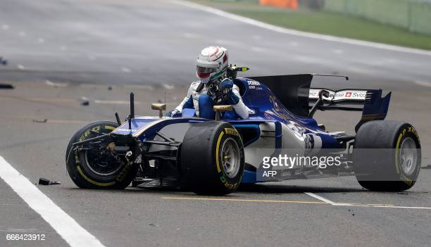 Sauber's Italian driver Antonio Giovinazzi sits in his car after it crashed during the Formula One Chinese Grand Prix in Shanghai on April 9 2017 /...