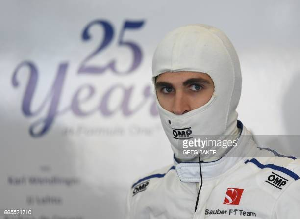 Sauber's Italian driver Antonio Giovinazzi waits in the pits during the practice session ahead of the Formula One Chinese Grand Prix in Shanghai on...
