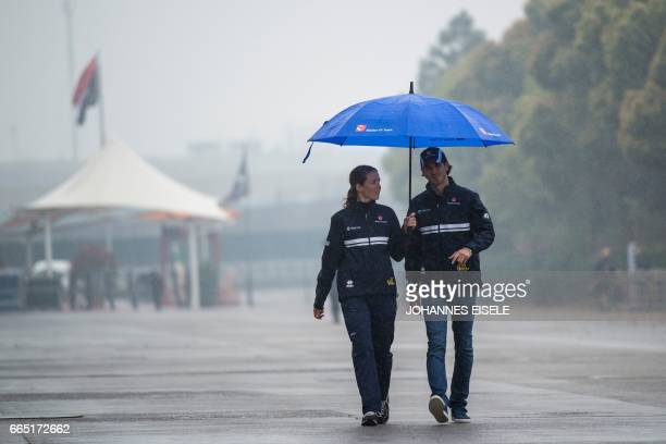 Sauber's Italian driver Antonio Giovinazzi walks in the paddock in Shanghai on April 6 ahead of the Formula One Chinese Grand Prix / AFP PHOTO /...