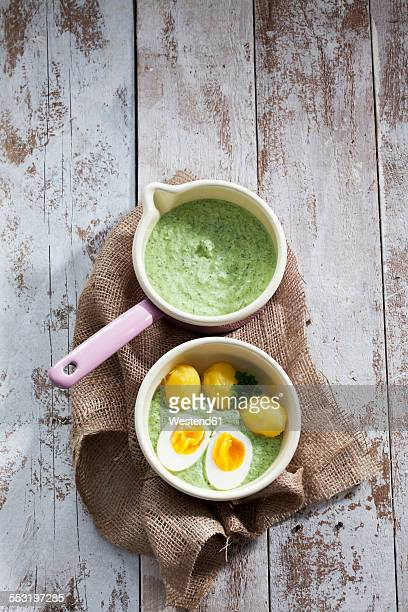 Saucepan of Frankfurt green sauce, boiled potatoes and boiled egg
