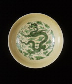 Saucer with green dragon on cafe au lait ground Yongzheng period Qing dynasty China 17231735 A cafe au lait glazed saucer decorated with an imperial...