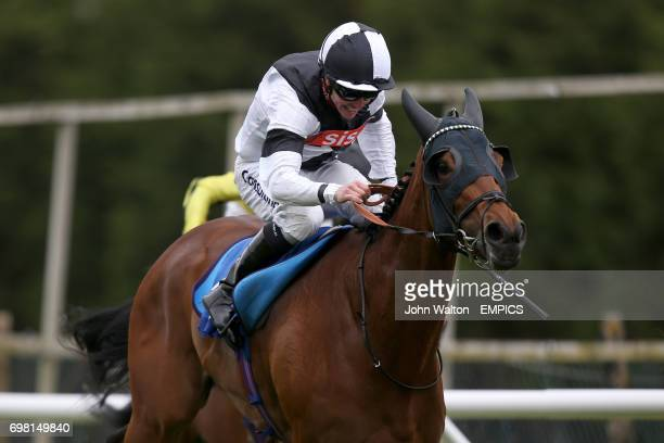 Saucy Minx ridden by Jim Crowley comes home to win The Janes' Solicitors Fillies' Handicap