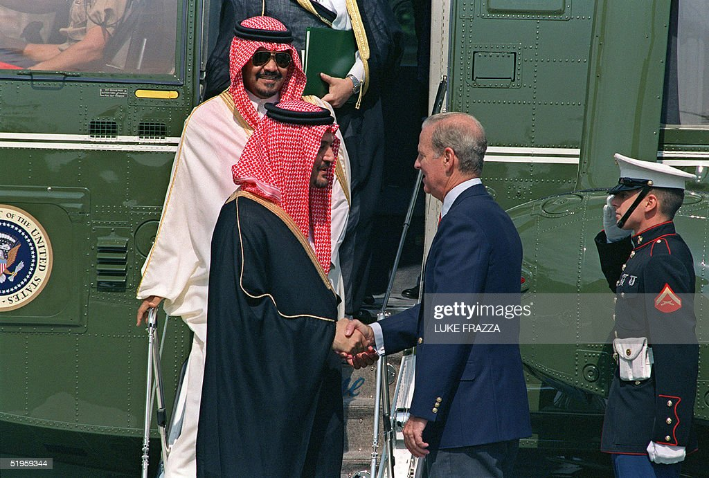 Saud al-Faisal (C), Crown Prince and Minister of Foreign Affairs of Saudi Arabia, shakes hands 16 August 1990 in Kennebunkport with US Secretary of State James Baker (R) as Prince Bandar bin Sultan bin Abdul Aziz al-Saud, the Saudi ambassador to the US looks on, at Walker's Point, prior to meet US President George Bush. Prince Saud al-Faisal, son of the late King Faisal, was born in Riyadh in 1942. He did his B.A. in economics at Princeton University, in USA in 1964. In 1971-74 he was the Deputy Minister of Petroleum and Mineral Wealth, and in 1975 became the Minister of Foreign Affairs. Prince Bandar was born in March 1949 at Taif, son of Prince Sultan bin Abdul Aziz al-Saud, the Second Deputy Prime Minister, Minister of Defense and Aviation.