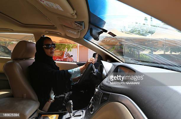 Saudi activist Manal Al Sharif who now lives in Dubai drives her car in the Gulf Emirate city on October 22 as she campagins in solidarity with Saudi...