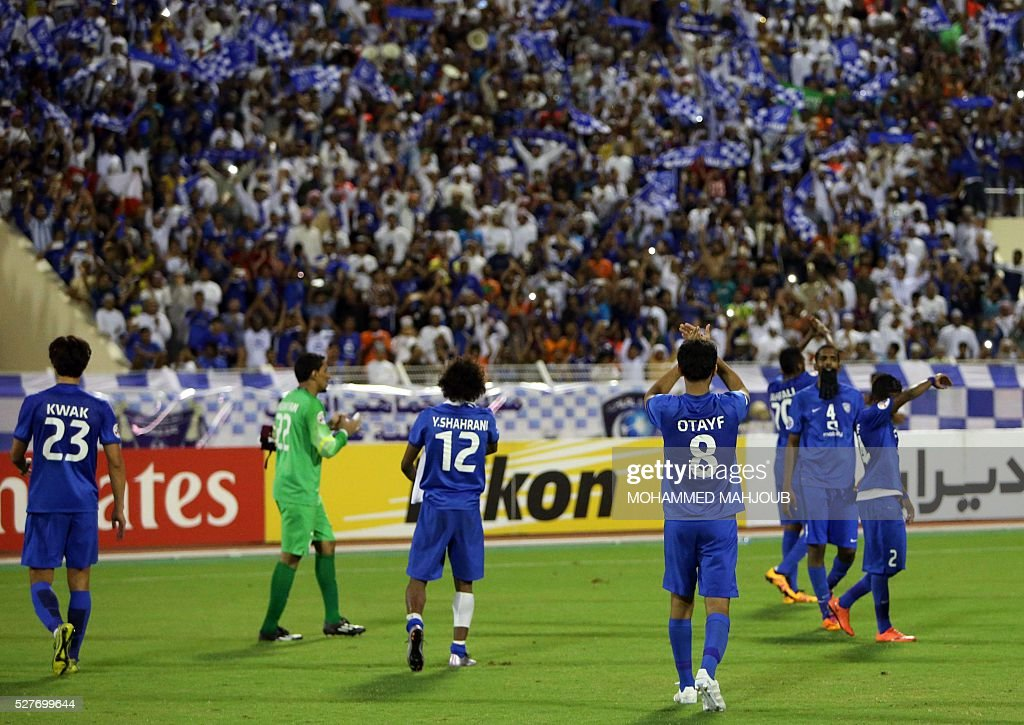 Saudi Al-Hilal club players celebrate after winning their Asian Champions League group C football match against Iranian club Tractorsazi at the Sultan Qabous stadium in Muscat on May 3, 2016. Al-Hilal won the match 2-1. MAHJOUB