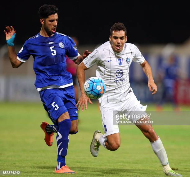 Saudi AlHilal FC's Carlos Eduardo vies for the ball against Iranian Esteghlal Khouzestan FC's Aghil Kaabi during the AFC Champions League qualifying...