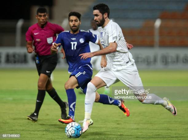Saudi AlHilal FC's Omar Khrbin dribbles the ball as Iran's Esteghlal Khouzestan FC's Salman Bahrani defends during the AFC Champions League...