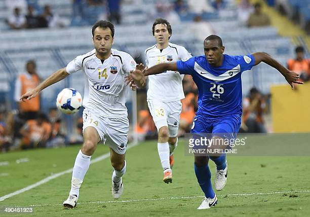 Saudi AlHilal player Digao vies with Uzbekistan's Bunyodkor player Vokhid Shodiev during their AFC Champions League round 16 qualifying football...