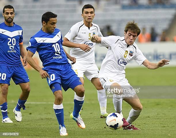 Saudi AlHilal's Mohammad alShalhoub vies with Uzbekistan's Bunyodkor player Jovlon Ibrokhimov during their AFC Champions League round 16 qualifying...