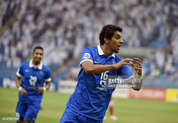 Saudi alHilal's Yousef alSalem celebrates a goal scored against Iran's FC Persepolis' team during their AFC Champions League football match on May 26...