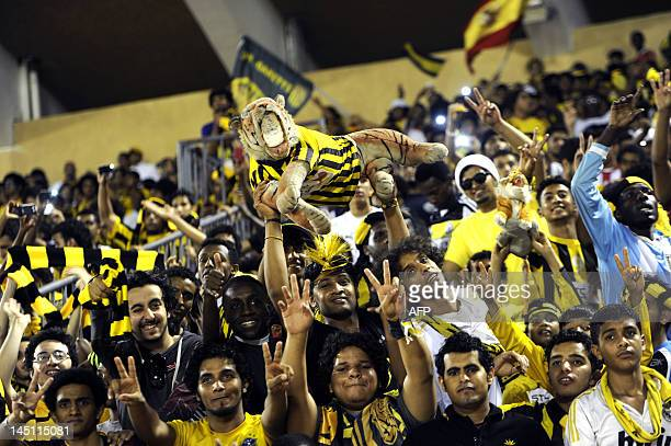 Saudi AlIttihad club fans cheer for their team during their AFC Champions League Round of 16 football match against Iran's Persepolis in the Red Sea...