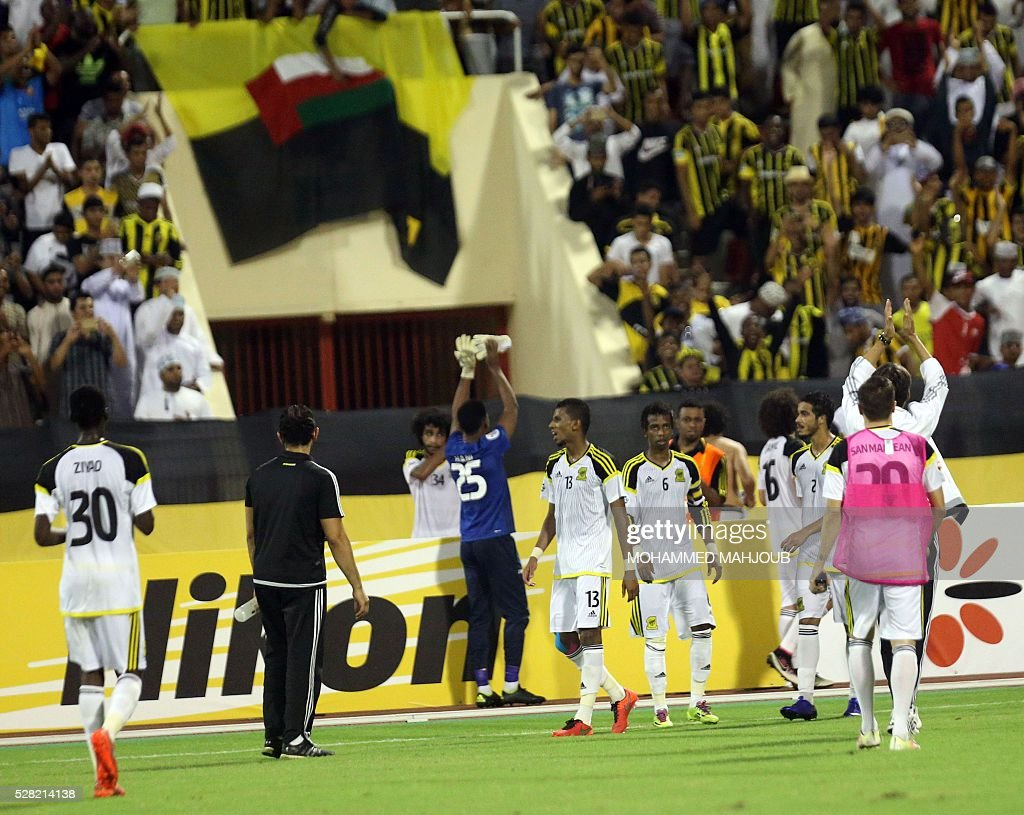 Saudi Al-Ittihad club's players celebrate after winning their Asian Champions League group A football match against Iranian Sepahan club at the Sultan Qabous stadium in Muscat on May 4, 2016. Al-Ittihad won 2-0. / AFP / MOHAMMED