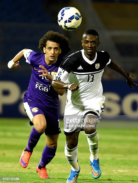 Saudi AlShabab's Hassan Fallatah fights for the ball with UAE AlAin's Omar Abdulrahman during their AFC champions League Group B football match at...