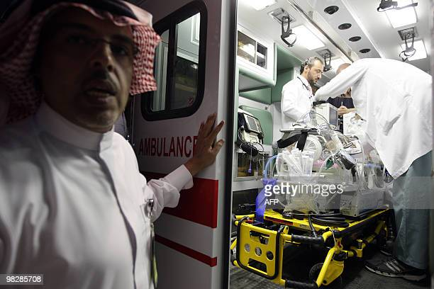 A Saudi ambulance awaits the transfer of coinjoined Palestinian twin girls girls Retag and Retal after they arrived in Riyadh from Rafah in the Gaza...