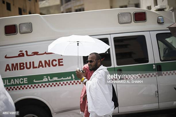 Saudi ambulances arrive with pilgrims who were injured in a stampede at an emergency hospital in Mina near the holy city of Mecca on the first day of...