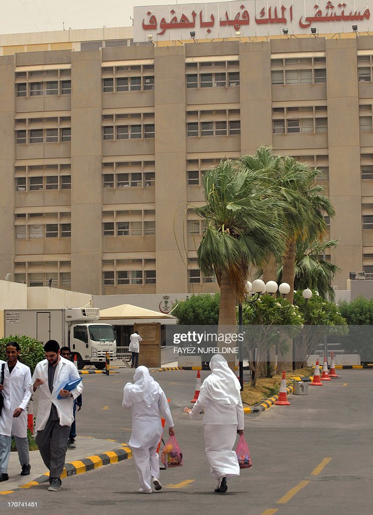 Saudi and foreign medical workers walk inside the compound of King Fahad hospital in the city of Hofuf, 370 kms East of the Saudi capital Riyadh, on June 16, 2013. Four people have died from the MERS virus in Saudi Arabia, bringing the death toll from the SARS-like virus in the kingdom to 32, the health ministry said. The World Health Organisation announced that the global death toll from MERS had reached 33, with 28 of them in the kingdom. The virus is a member of the coronavirus family, which includes the pathogen that causes Severe Acute Respiratory Syndrome (SARS).
