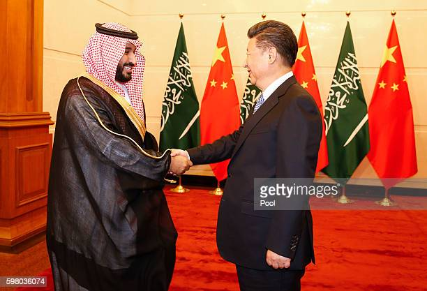 Saudi Arabia Deputy Crown Prince Mohammed bin Salman greets Chinese President Xi Jinping during a meeting at the Diaoyutai State guest house on...
