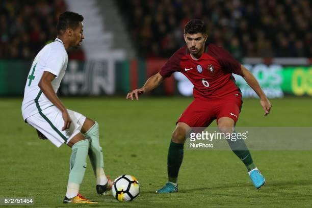 Saudi Arabia forward Salman Al Muwashar and Portugal midfielder Ruben Neves during the match between Portugal v Saudi Arabia International Friendly...