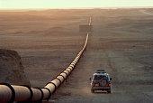Saudi Arabia, main oil pipeline, car driving by at dusk