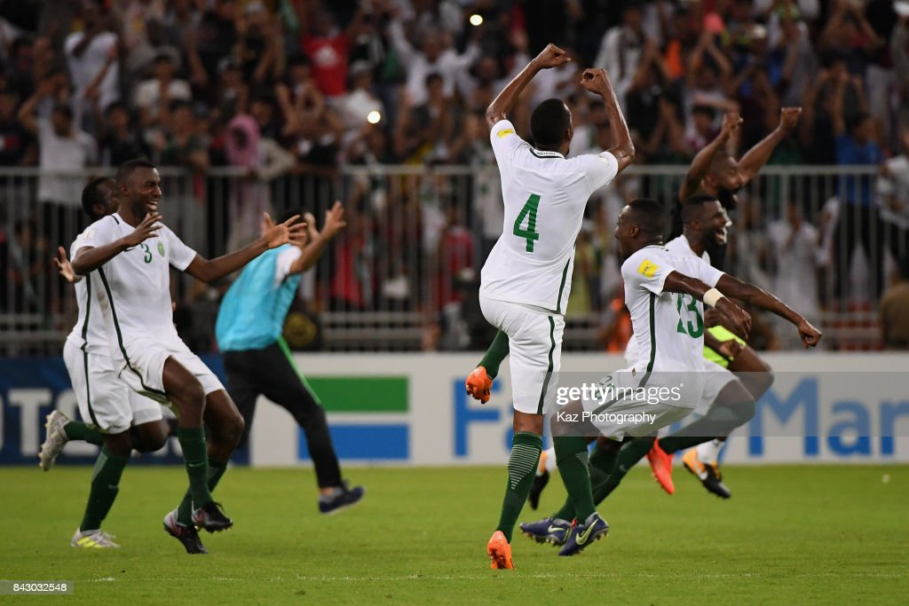 Saudi Arabia players celebrate their 1-0 victory and qualified for the FIFA World Cup Russia after the FIFA World Cup qualifier match between Saudi Arabia and Japan at the King Abdullah Sports City on September 5, 2017 in Jeddah, Saudi Arabia.