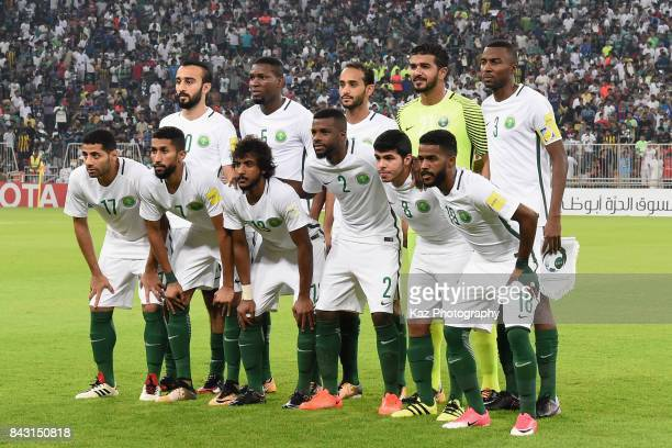 Saudi Arabia players line up for the team photos prior to the FIFA World Cup qualifier match between Saudi Arabia and Japan at the King Abdullah...