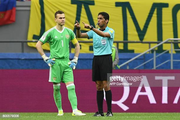 Saudi Arabia referee Fahad alMirdasi gestures to eliminate a goal as Russia's goalkeeper Igor Akinfeev stands by during the 2017 Confederations Cup...
