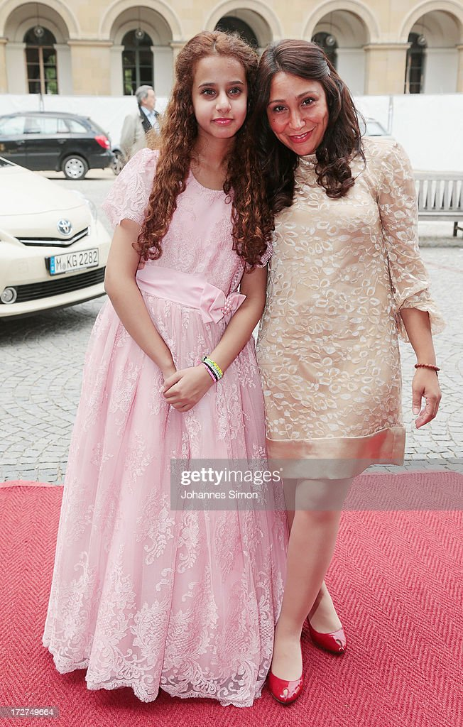 Saudi Arabian actress and award winner Waad Mohammed (L) and Saudi Arabian director Haifaa Al Mansour arrive for the Bernhard Wicki Award ceremony at Munich Film Fesitval on July 4, 2013 in Munich, Germany.