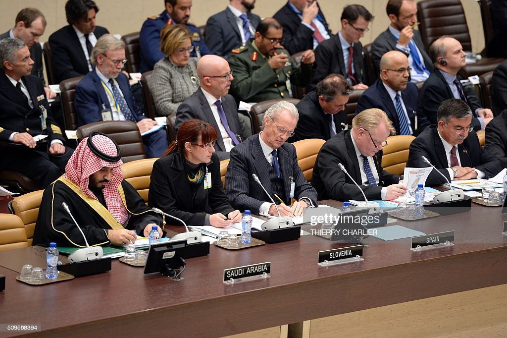 Saudi Arabian Defence Minister Prince Salman Bin Abdulaziz, Slovenian Defence Minister Andreja Katic, Spanish Defence Minister Pedro Morenes Eulate, Swedish defence minister Peter Hultqvist and Turkish Defence Minister Ismet Yilmaz listen to an unseen speaker during the Global Coalition meeting against the Islamic State group IS held at NATO headquarter in Brussels on February 11, 2016. / AFP / THIERRY CHARLIER