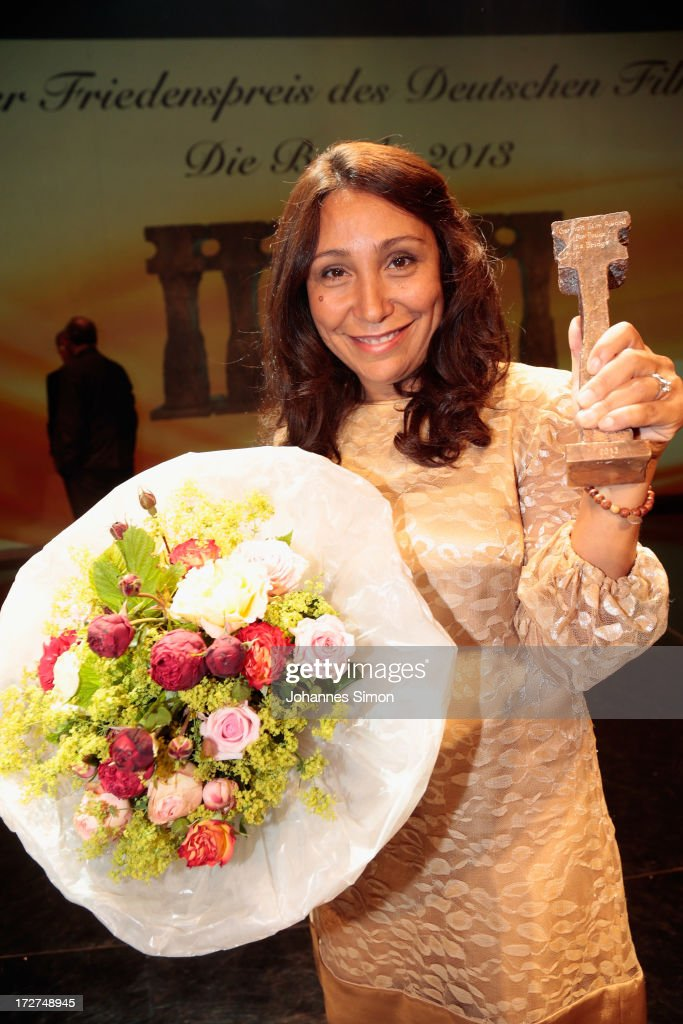 Saudi Arabian director and award winner <a gi-track='captionPersonalityLinkClicked' href=/galleries/search?phrase=Haifaa+al-Mansour&family=editorial&specificpeople=4041917 ng-click='$event.stopPropagation()'>Haifaa al-Mansour</a> poses with the award trophy after the Bernhard Wicki Award ceremony at Munich film festival on July 4, 2013 in Munich, Germany.