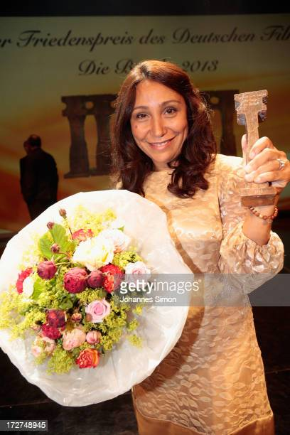 Saudi Arabian director and award winner Haifaa alMansour poses with the award trophy after the Bernhard Wicki Award ceremony at Munich film festival...