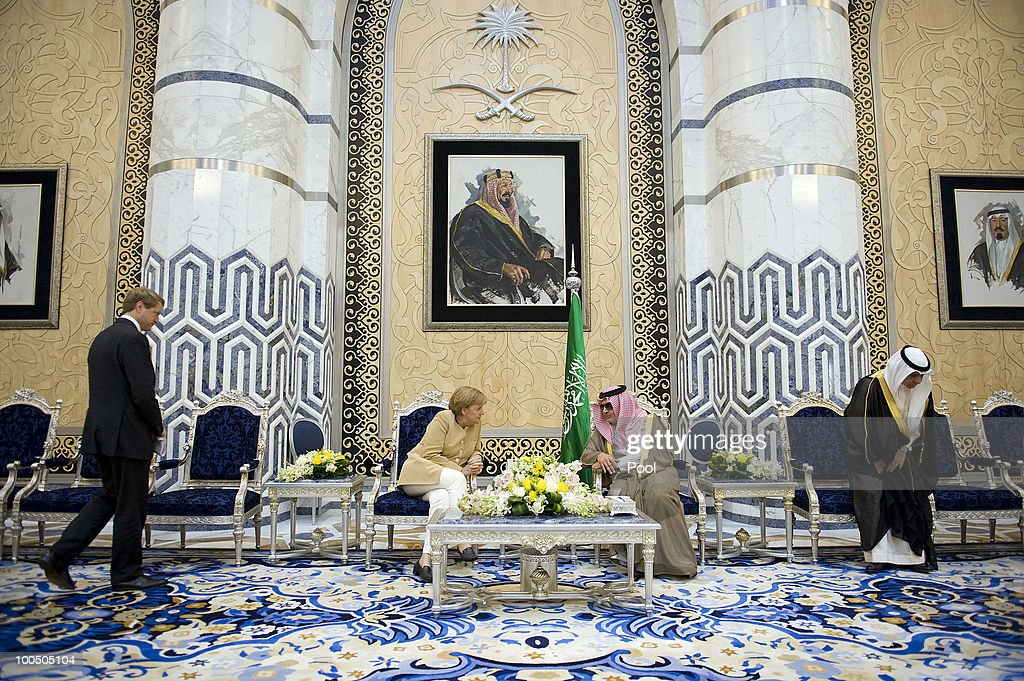 Saudi Arabian Foreign Minister Prince Saud al-Faisal Bin Abdulaziz Al Saud welcomes German Chancellor <a gi-track='captionPersonalityLinkClicked' href=/galleries/search?phrase=Angela+Merkel&family=editorial&specificpeople=202161 ng-click='$event.stopPropagation()'>Angela Merkel</a> in the Royal Entrance hall on May 25, 2010 in Djidda, Saudi Arabia. Merkel began her four-day tour of the Gulf region in the United Arab Emirates on May 24 to promote the Middle East peace process. Political talks in the United Arab Emirates, Bahrain, Qatar and Saudi Arabia will also be dominated by regional security issues and the nuclear standoff with Iran.