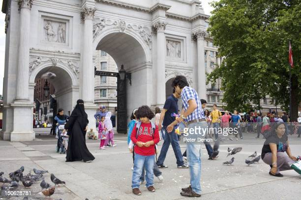 Saudi Arabian man feeds the pigeons at Marble Arch in central London Arabs have been visiting London for centuries and around 300000 Arabs have...