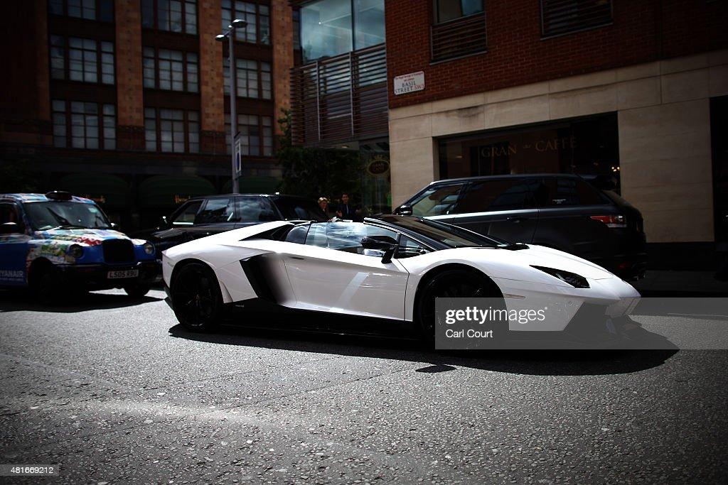 Saudi Arabian registered Lamborghini is driven through Knightsbridge on July 21 2015 in London England Knightsbridge has become known in recent years...