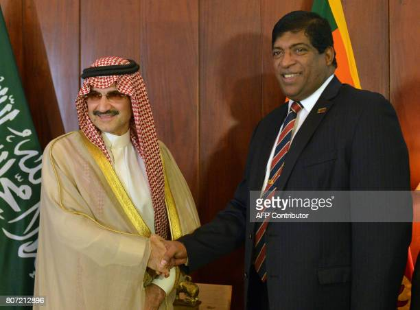 Saudi Arabian royal AlWaleed Bin Talal bin Abdulaziz al Saud and Sri Lankan Foreign Minister Ravi Karunanayake shake hands ahead of a meeting in...