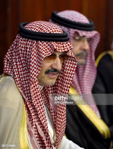 Saudi Arabian royal AlWaleed Bin Talal bin Abdulaziz al Saud looks on during a meeting with Sri Lankan Foreign Minister Ravi Karunanayake in Colombo...