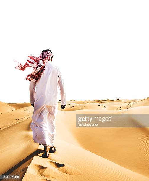 Saudi Arabian Sheik walking on the desert