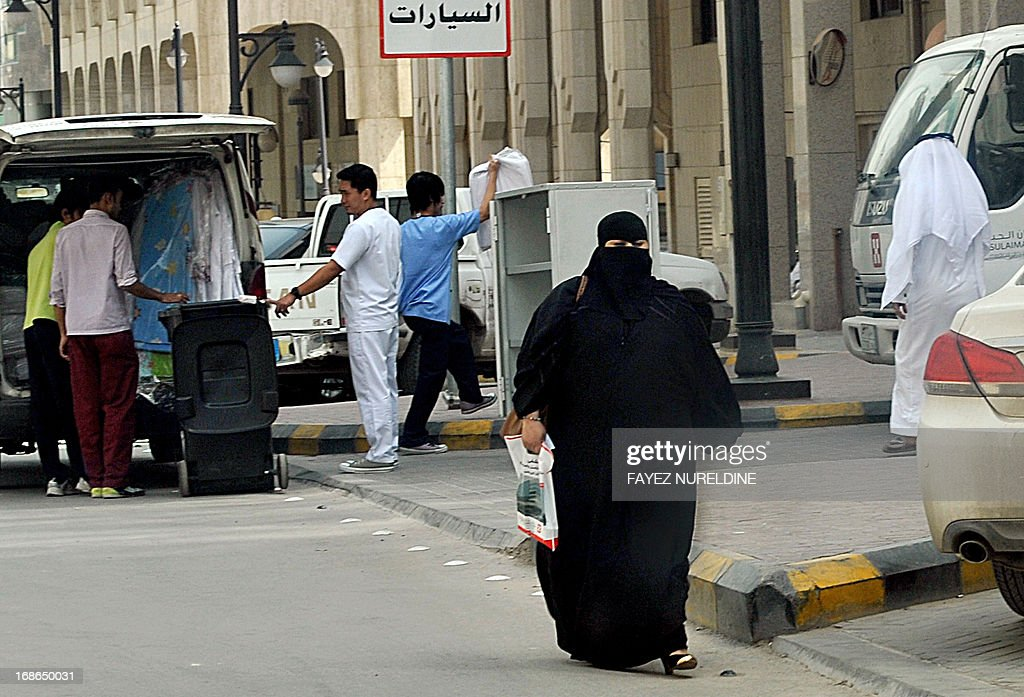 A Saudi Arabian woman walks past a local hospital in the center of the Saudi capital Riyadh, on May 13, 2013. Fifteen people in Saudi Arabia have died from a SARS-like virus out of 24 people who contracted it since last August, Health Minister Abdullah al-Rabia said on May 12.