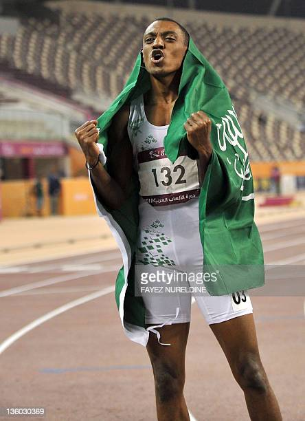 Saudi Arabia's Ahmed Khader alMuallad celebrates after winning the men's 110m hurdles final at the 2011 Arab Games in the Qatari capital Doha on...